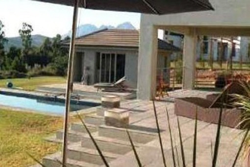 Terrace with pool and pool house as well as a garden