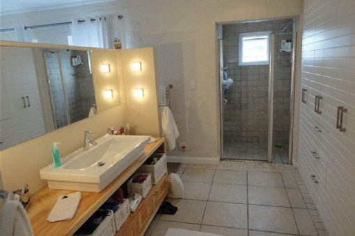 Bathroom with large wall closets and basin